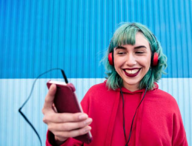 female happily listen to music