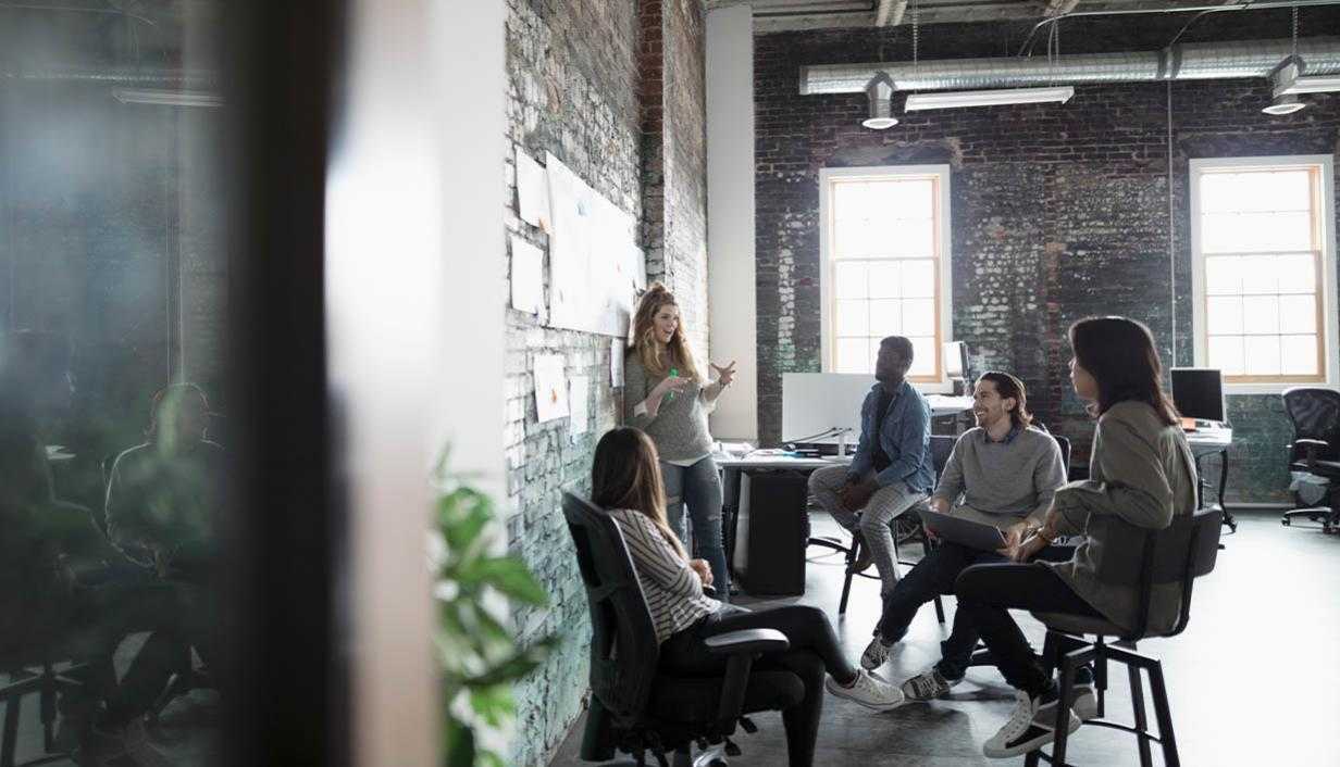 A group of colleagues in a brick building.