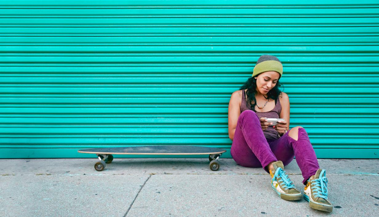 woman with skateboard and phone.jpg