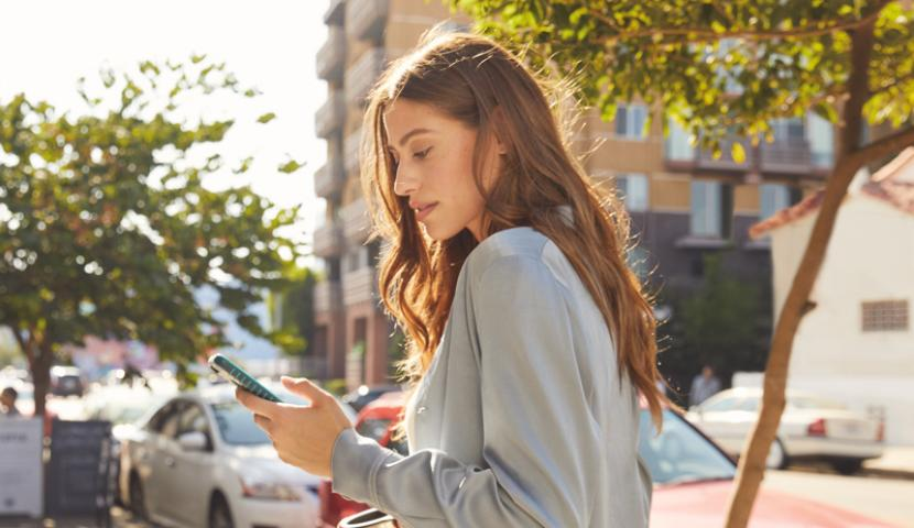 Woman outdoors on a mobile phone